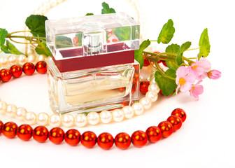 perfume bottle, flowers, chaplet on white background