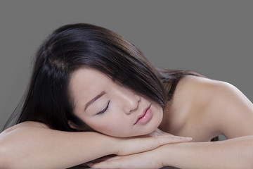 Woman relaxing in studio after skin treatment