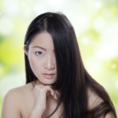 Woman with pure skin and black hair