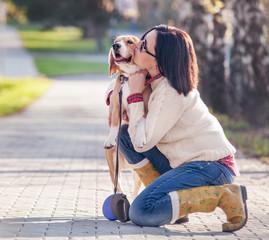 Woman hugs her favorite pet