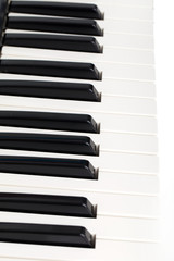 Side view of electronic piano keyboard keys. Macro