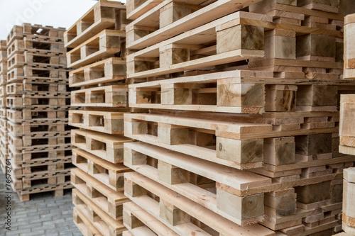 Leinwandbild Motiv Stock wooden pallets