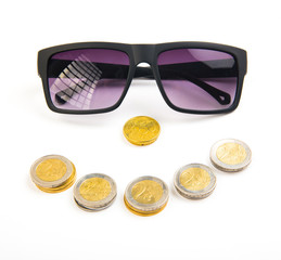 Money and success concept. Black sunglasses with smile face from