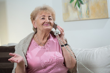 Talking on stationary telephone