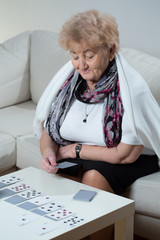 Elder woman playing solitaire