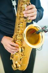 man playing jazz saxophone closeup
