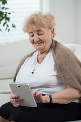 Active senior woman using tablet