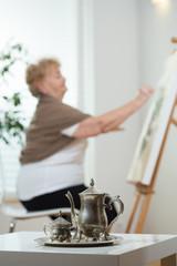 Senior artist painting picture