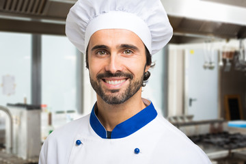 Smiling chef in his kitchen