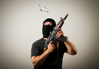 Man with gun and peace dove.