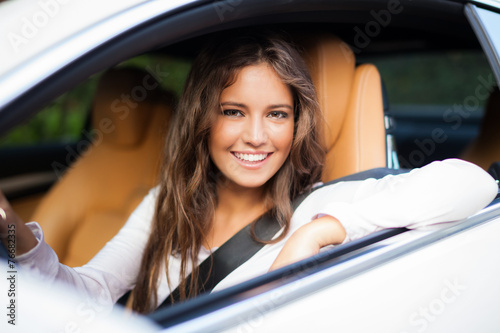 Woman driving her car - 76682335