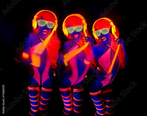Leinwandbild Motiv sexy neon uv glow dancer with hulahoop