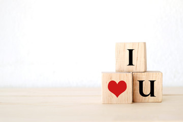 """Three wood cubes with """" I love you """" words"""
