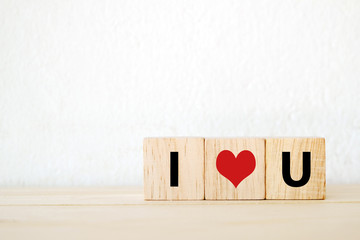 "Three wood cubes with "" I love you "" words"