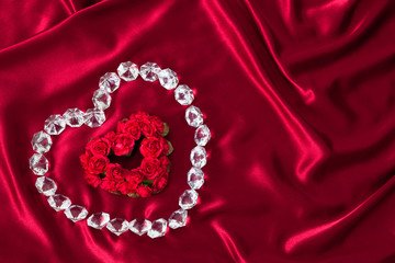 Heart shaped Roses outlined with diamonds on red satin (P)