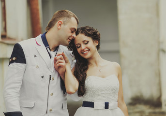 Groom and bride together having, portrait of a young wedding cou