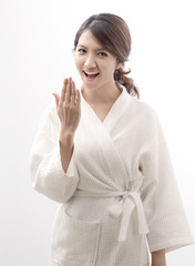 asian woman in bathrobe , morning mood