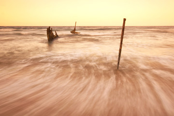 The S.S Dicky Shipwreck at Dicky Beach. Afternoon sunset .