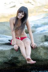 Lady wearing red and animal print striped bikini