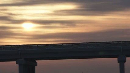 Winter highway on the bridge against sunset sky