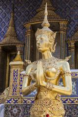 a graceful golden kinaree image on blue sky background, Thai myt