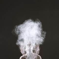 Bare Woman Throwing Head Back with Smoke Effect