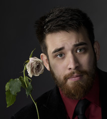 Close up Good Looking Goatee Man with White Rose