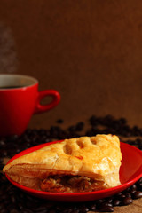 Coffee red cup  and mushroom puff pastry.