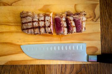 Rare beef rump steam on a chopping block