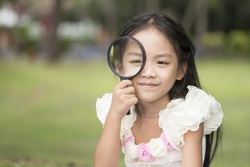 Little asian girl in park