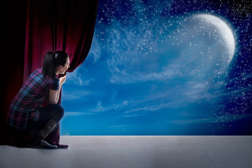 girl opens the curtain and entrance in the magical world of moon