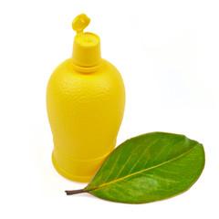 Plastic bottle of lemon juice to the sauce isolated on white bac