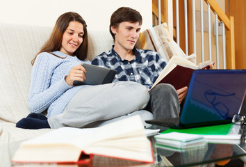 man and woman preparing for exams