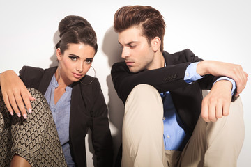 Young fashion couple sitting on the floor