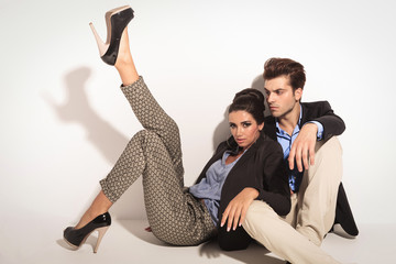 Sexy fashion woman leaning on her lover