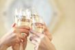 Leinwandbild Motiv Glasses of champagne in female hands on a party