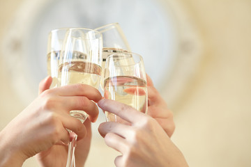 Glasses of champagne in female hands on a party