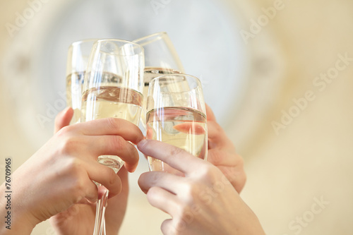 canvas print picture Glasses of champagne in female hands on a party