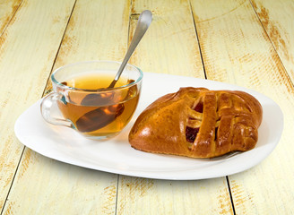 image of a cup of tea and buns on a table