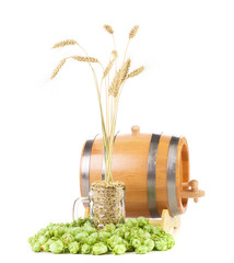 Wooden barrel with hops