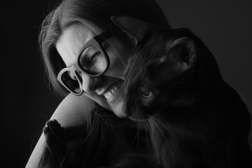 Portrait of happy woman with her cat