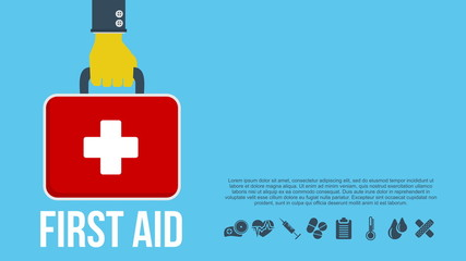 First aid kit concept with hand holding medicine chest