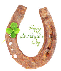 Old horse shoe with clover leaf isolated