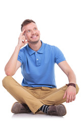 seated young casual man pondering