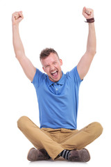 seated young casual man cheering