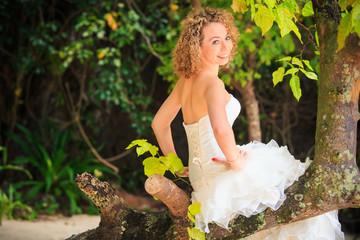 blonde bride sit on tree