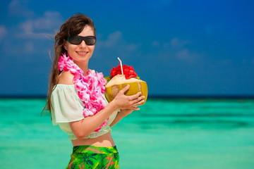 Maldives, women with coconut