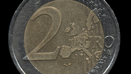 detailed 2 euro coin zoom out on black background