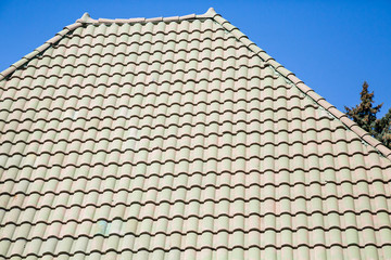 Green Tile Roof Under Blue Sky