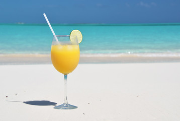 Orange juice on the beach. Great Exuma, Bahamas